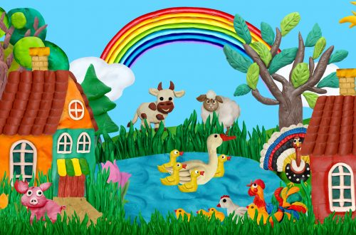 summer village banner with farm animals houses sculptures